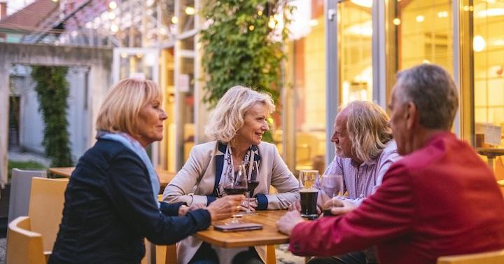 Happy Senior Couples Taking Outdoor Selfie at Ljubljana Cafe